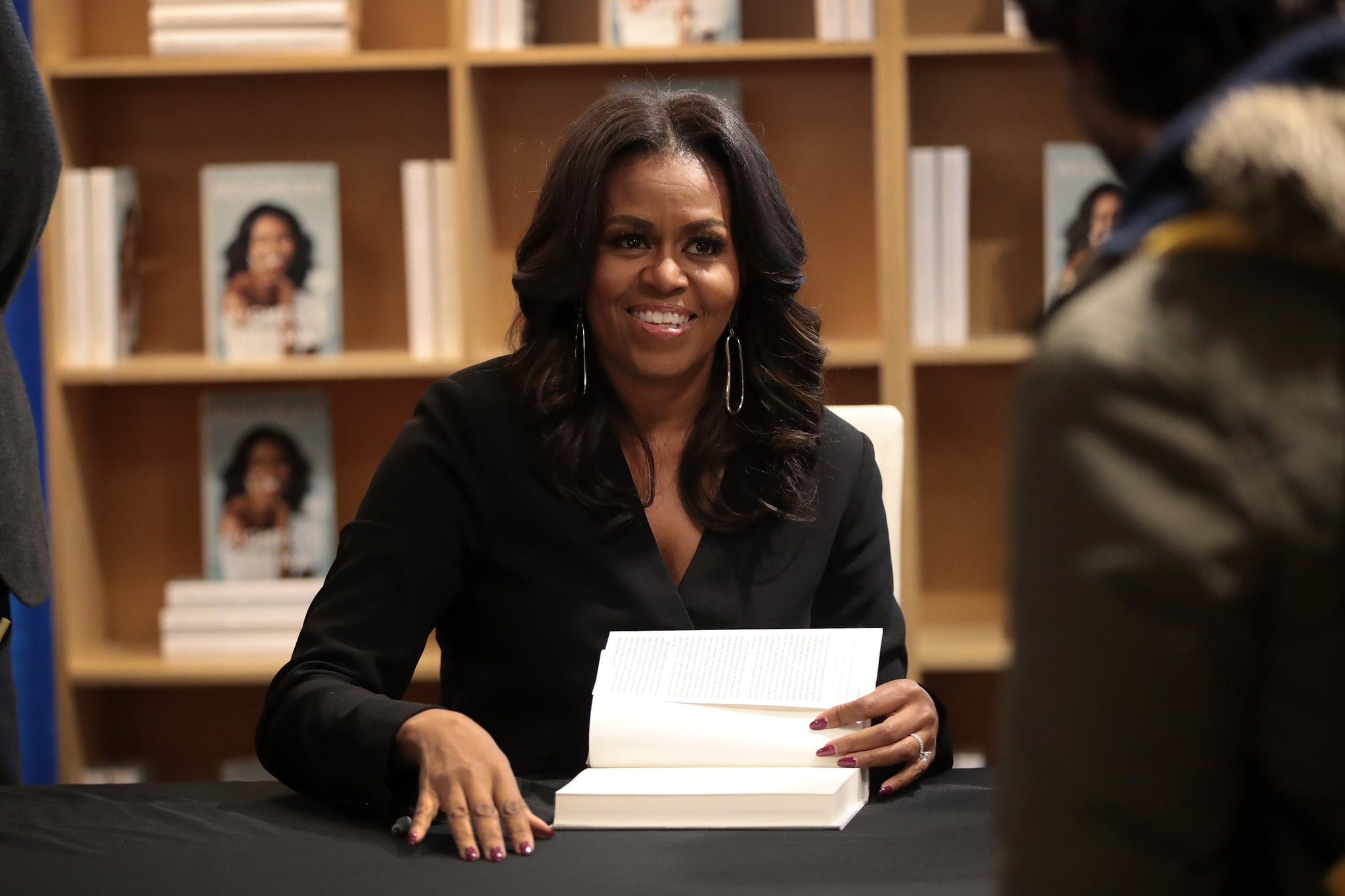 CHICAGO, IL - NOVEMBER 13:  Former first lady Michelle Obama kicks off her ?Becoming? book tour with a signing at the Seminary Co-op bookstore on November 13, 2018 in Chicago, Illinois. In the book, which was released today, Obama describes her journey from Chicago's South Side to the White House.  (Photo by Scott Olson/Getty Images)