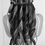 "This gorgeous waterfall braid has been all over pin boards for months. It was originally done by Tumblr blogger High Top Taylors, who says the style was a traditional waterfall plait, ""but when I did it, I also curled the hair."""
