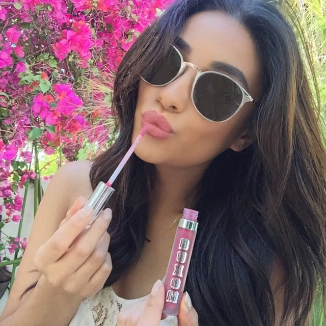 Her lip gloss is poppin' — and so are those sunglasses.