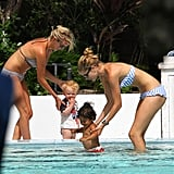 Doutzen Kroes stayed in the shallow end of the pool with Phyllon James.