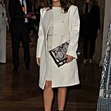 Salma Hayek went for an all-white look, topped off by ballerina-inspired heels, for Stella McCartney's A/W '12 show.