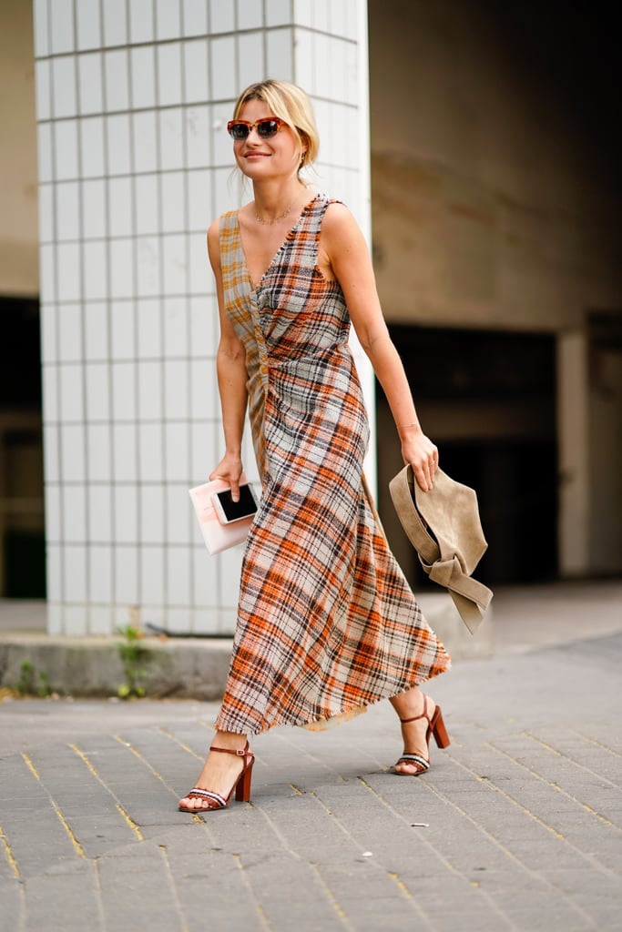 Give a plaid pattern the boho treatment in a flowing silhouette; then add a suede bag to drive it home.