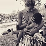 This beautiful photo of Doutzen Kroes nursing Myllena with Phyllon playing nearby is so sweet.