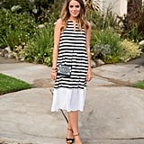 A striped dress is a Summer staple. Style with a mini crossbody bag and sweet wedges — et voilà! The easiest look for date night or drinks with the girls.  Source: Instagram user galmeetsglam