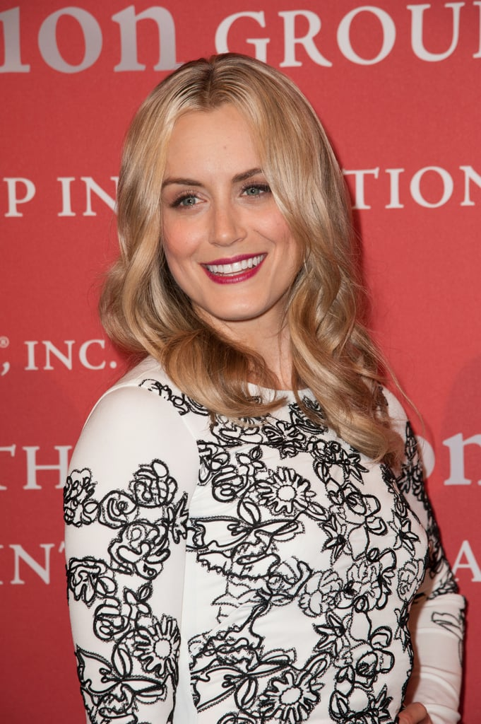 Taylor Schilling brought out her glamorous side with a crimson lip color and loose curls on the red carpet last night.