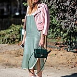 If you're wearing a colorful dress, consider wearing an equally as colorful boot. The pink and green hues in this outfit work because they're in the same color family aka pastels. This street style star is giving us the ultimate mermaid vibes.