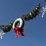 Tire wreaths hang high over the main street of Cars Land.