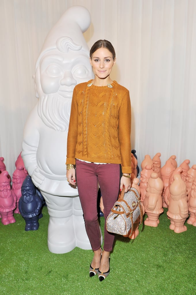 Olivia Palermo played with contrasting hues on her pullover and her red skinnies — with a Mulberry bag in tow at the label's Spring show.