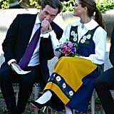 Madeleine's husband gave her a kiss on Sweden's national day — hence her traditional costume.