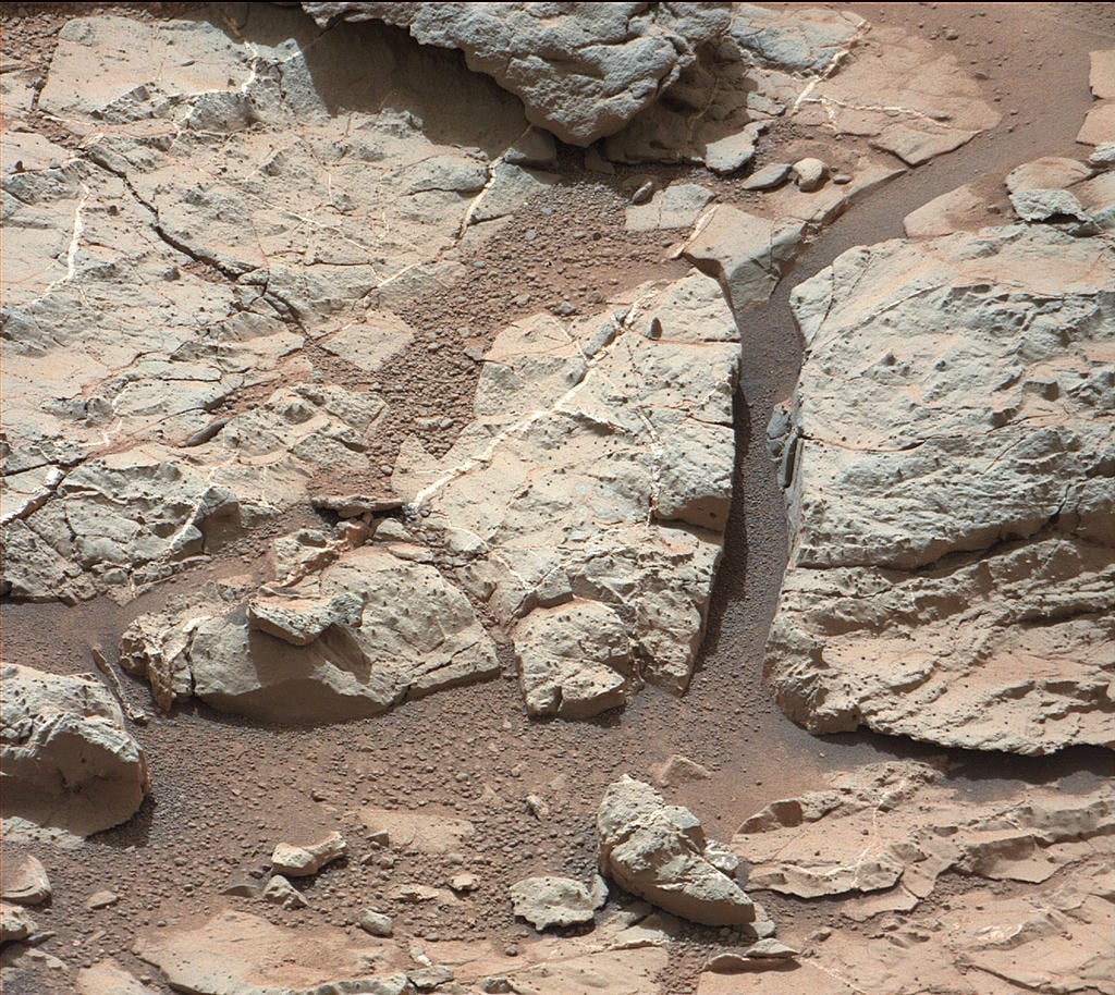 "Here's a picture taken at a location called ""Sheepbed,"" which shows well-defined veins filled with whitish minerals that we think is calcium sulfate. The veins form when water circulates through fractures, depositing minerals along the sides of the fracture.  Source: NASA/JPL-Caltech/MSSS"