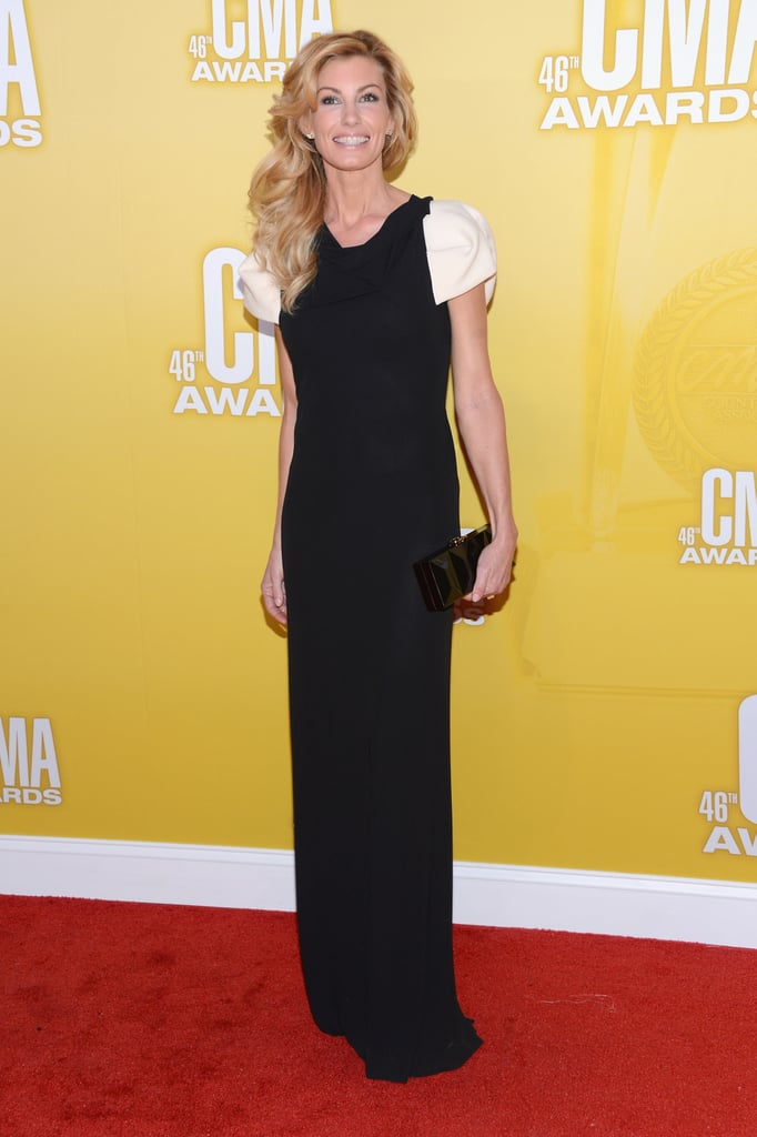 Faith Hill was the only country starlet to take a much darker approach to her eveningwear, donning a mostly black Roland Mouret dress. The slightly ruched white cap sleeves provided a sweet contrast in tone. To finish it off, she toted a black Roger Vivier clutch.