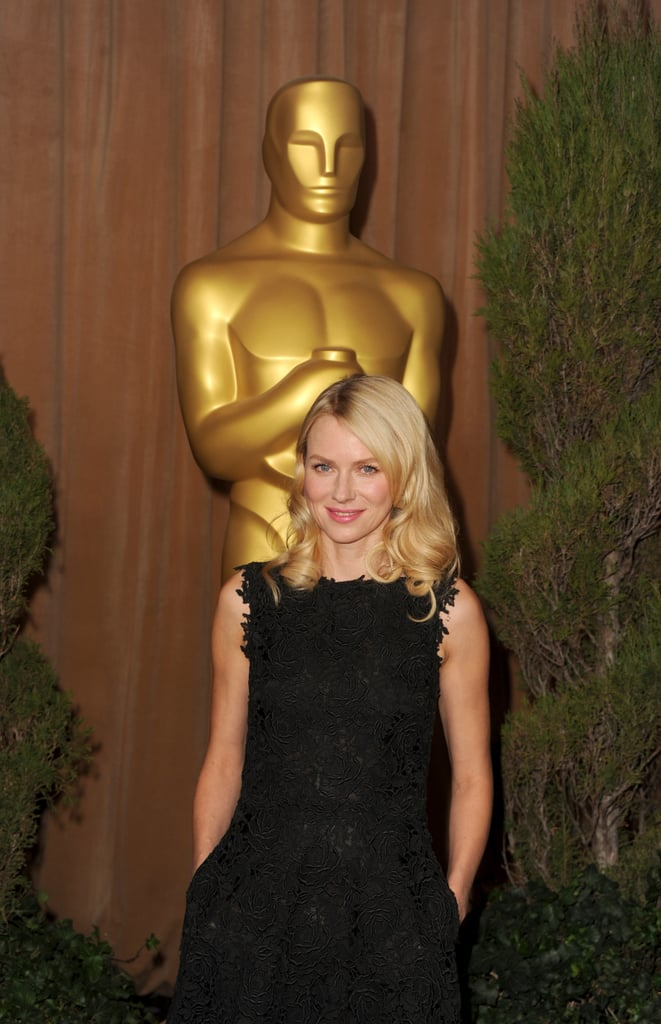 Naomi Watts tucked her hands in her pocketed black dress on the red carpet at the Oscars luncheon.