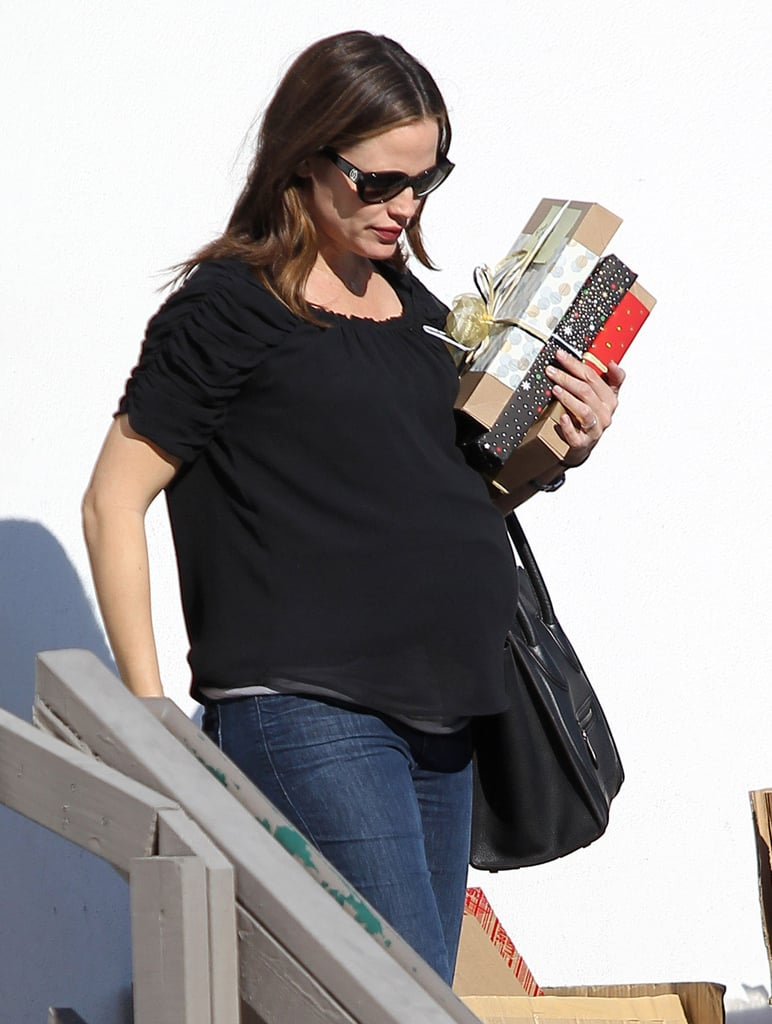 Jennifer Garner picked up three wrapped packages.