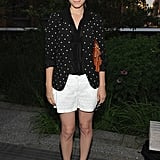 Kate Mara suited up the right way for Summer in a cheeky polka-dot Madewell blazer and white shorts. She dressed up the look with a pair of classic pumps that elevated her ensemble without countering her low-maintenance vibe.