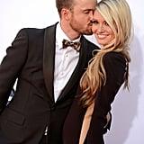 Aaron Paul gave his fiance, Lauren Parsekian, a kiss.