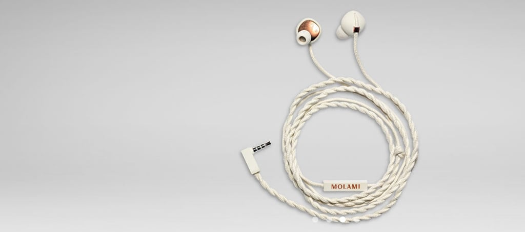 """The headphones: Molami's Stitch Earbuds ($49)   The why: """"Not only are they super stylish (can't ever go wrong with a black/gold or white/copper combo), but they're one of the most comfortable earbuds I've ever used. Thanks to their angled shape, I can wear them for hours at my desk or working out and they never hurt my ears like the generic Apple ones do."""" — Lisette Mejia, editor, News"""
