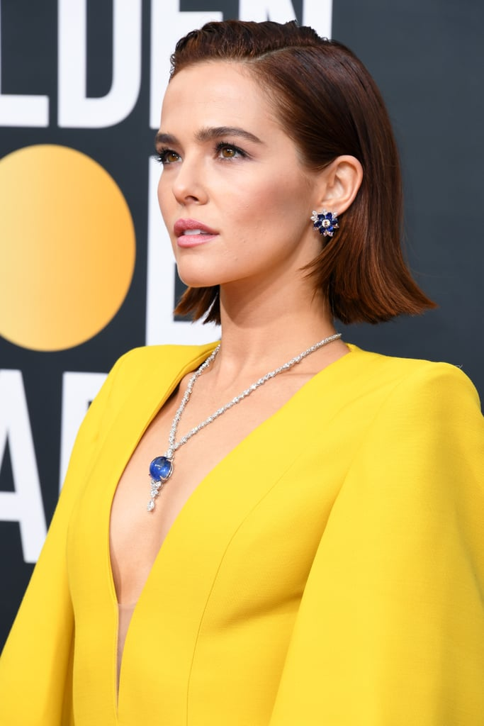 The last time viewers saw the Heart of the Ocean, it was being gleefully flung from a cruise ship. And yet, it appears the diamond necklace famously featured in Titanic has made its way onto the 2020 Golden Globes red carpet by way of Zoey Deutch. The Politician actress paired her vibrant Fendi jumpsuit with a strikingly similar necklace by Harry Winston. Though this particular necklace's sapphire pendant isn't heart-shaped, the entire thing consists of over 110 carats so . . . there's that. See pictures of the extravagant accessory ahead.