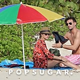 Olivia Palermo and boyfriend Johannes Huebl laid out on the sand.