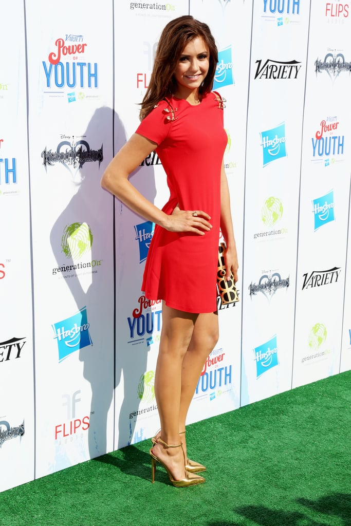 Nina Dobrev was red-hot in a short-sleeved Versus Versace minidress and gold T-strap pumps at the Power of Youth event in LA.