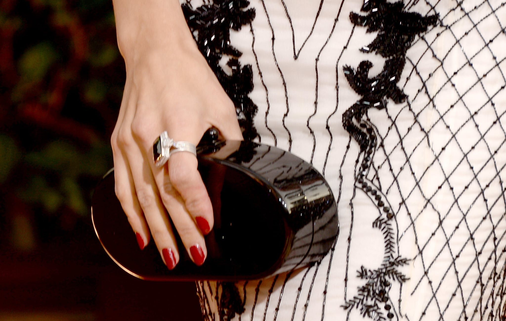 Jenna Dewan kept it coordinated with a black Edie Parker clutch and an Irene Neuwirth cocktail ring.