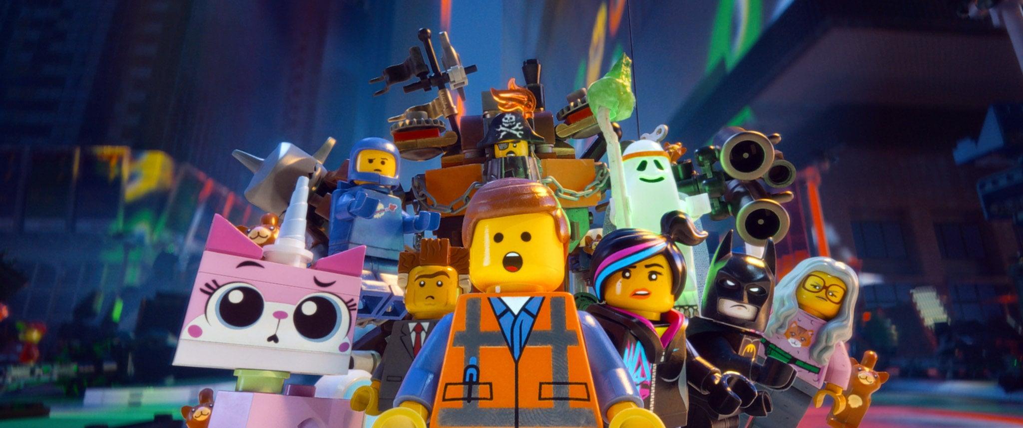 THE LEGO MOVIE, Unikitty (voice: Alison Brie), Benny (voice: Charlie Day), Metal Beard (Nick Offerman), Vitruvius (voice: Morgan Freeman), Batman (voice: Will Arnett), Wyldstyle (voice: Elizabeth Banks), Emmet (voice: Chris Pratt), President Business (voice: Will Ferrell), 2014. Warner Bros. Pictures/courtesy Everett Collection