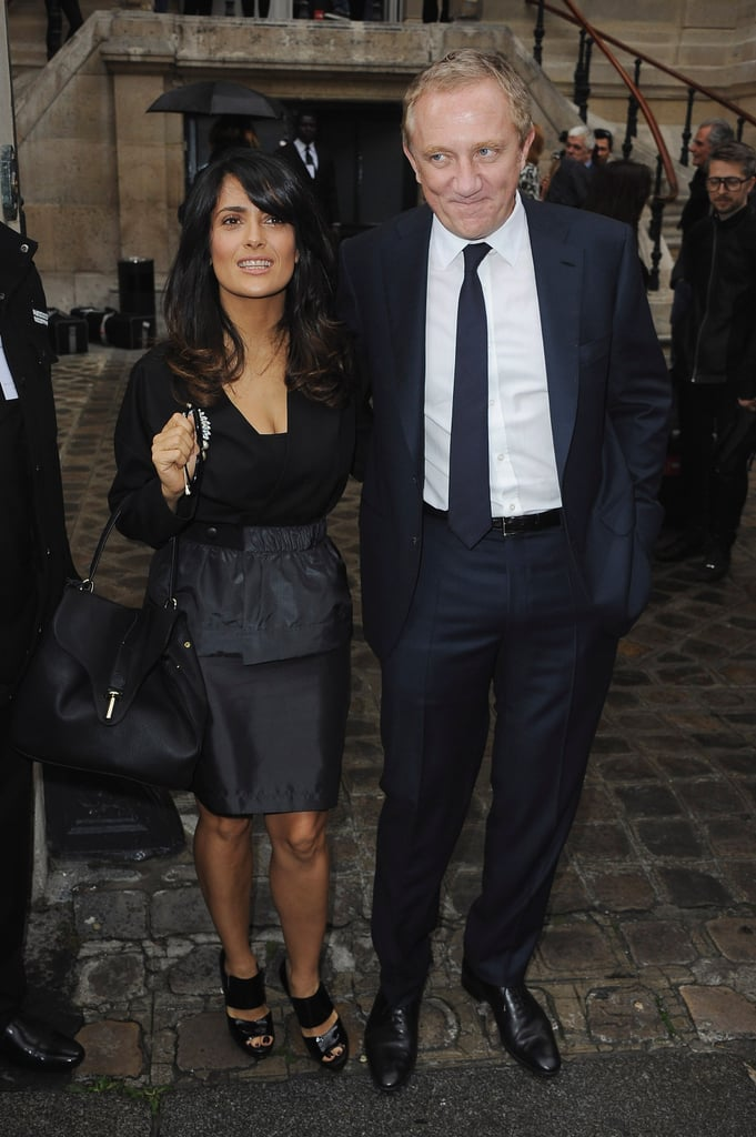 Salma Hayek had her husband, Francois-Henri Pinault, by her side this morning at Balenciaga's Paris Fashion Week runway presentation. The actress is a frequent fixture at fashion shows, with Francois serving as chairman and CEO at the parent company that owns Balenciaga and several other major design houses, including Alexander McQueen, Stella McCartney, and Gucci.  Salma was one of several high-profile attendees at today's show. Kristen Stewart attended Balenciaga's presentation as well. As the face of the brand's Florabotanica fragrance, the actress is often spotted wearing its designs, and appears in the perfume's ad campaign. For her part, Salma headed to Paris for the fashionable festivities after spending some time in Italy earlier this week. The actress debuted her film Savages in Rome with her costar John Travolta and their director, Oliver Stone.