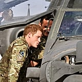 Prince Harry examined an Apache helicopter in Afghanistan.