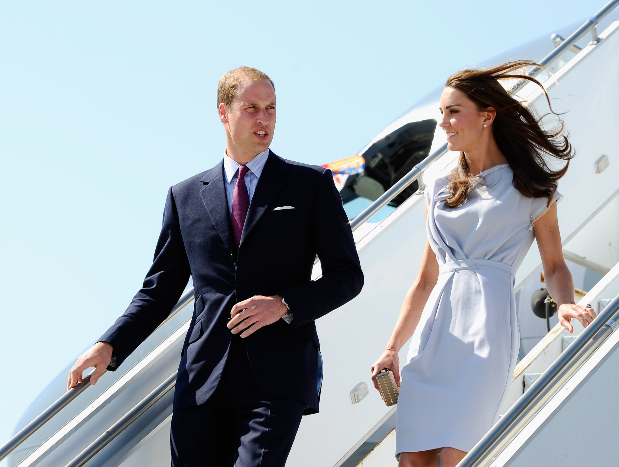 Prince William looked dapper in a navy suit next to Kate Middleton in lavender.