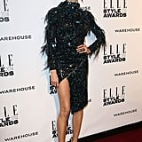 Karolina Kurkova flashed some flesh in this sculptural and embellished mini dress, adding black pumps to perfect the look.