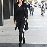 Gigi wearing her black suede Mitten booties.