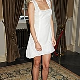 In July 2011, a fresh-faced Suki picked an angelic little white dress and contrasting black strappy sandals for a society party.