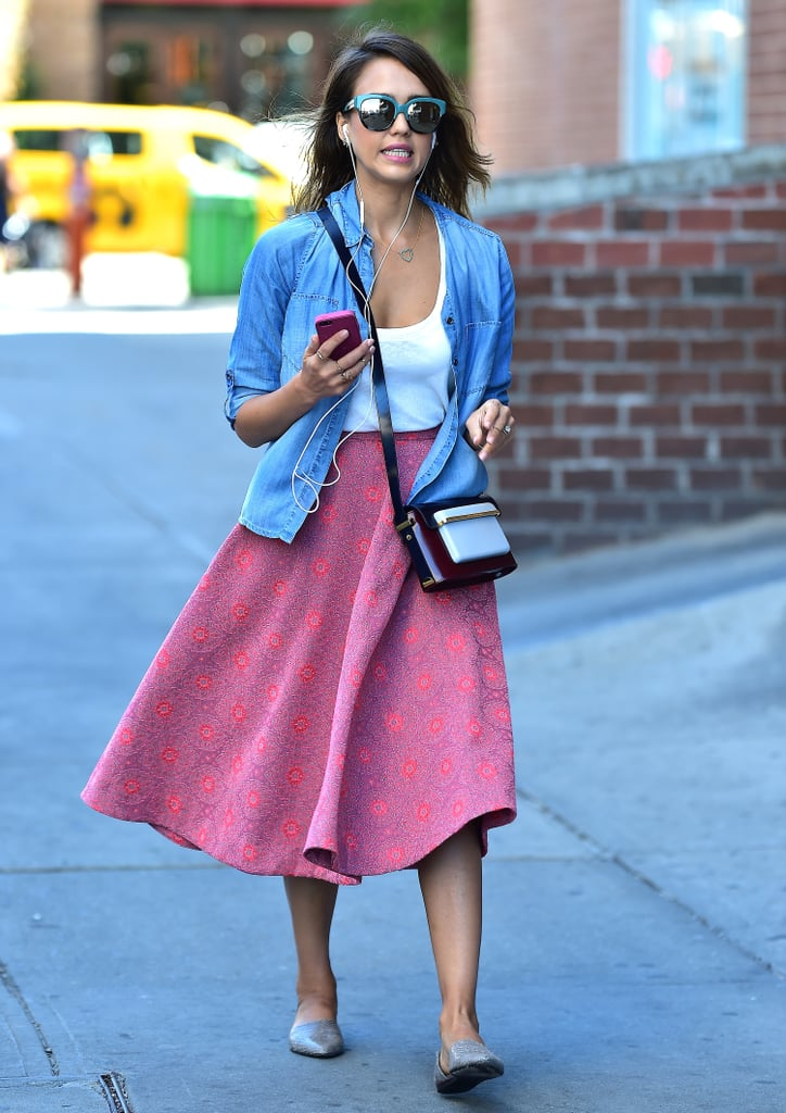 The star's key pieces both rung in for less than £55. Her loose denim chambray shirt, from H&M, was only £20, and her thick, woven skirt with a circled pink textured pattern was also from H&M and cost just £35. Sure, her crossbody bag, a Mary Katrantzou multicoloured MVK Medium satchel from the Autumn 2014 collection, cost a cool £1,250, but let's focus on the fact that her budget-friendly pieces pair seamlessly with the high-priced purse.