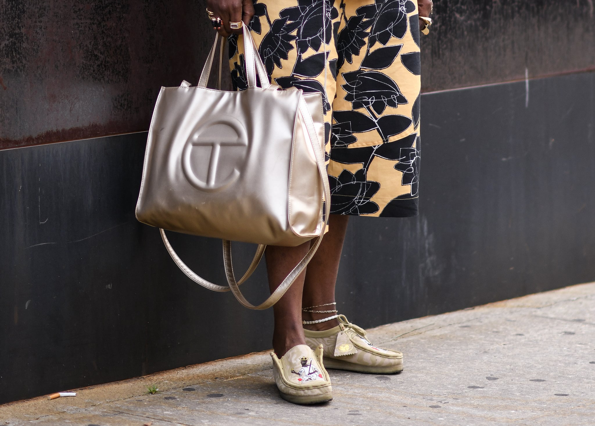 NEW YORK, NEW YORK - SEPTEMBER 16: A guest is seen wearing a Jacquemus shirt, Phillip Lim shorts and a Telfar bag outside the Studio 189 show during New York Fashion Week S/S21 on September 16, 2020 in New York City. (Photo by Daniel Zuchnik/Getty Images)