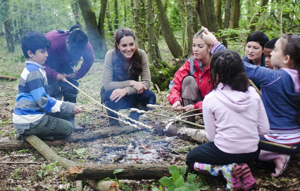 Kate Middleton hung out around the campfire with children from Expanding Horizons primary school outdoor camp.