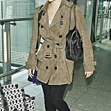Emma Watson paired her casual traveling attire with a dark fedora.