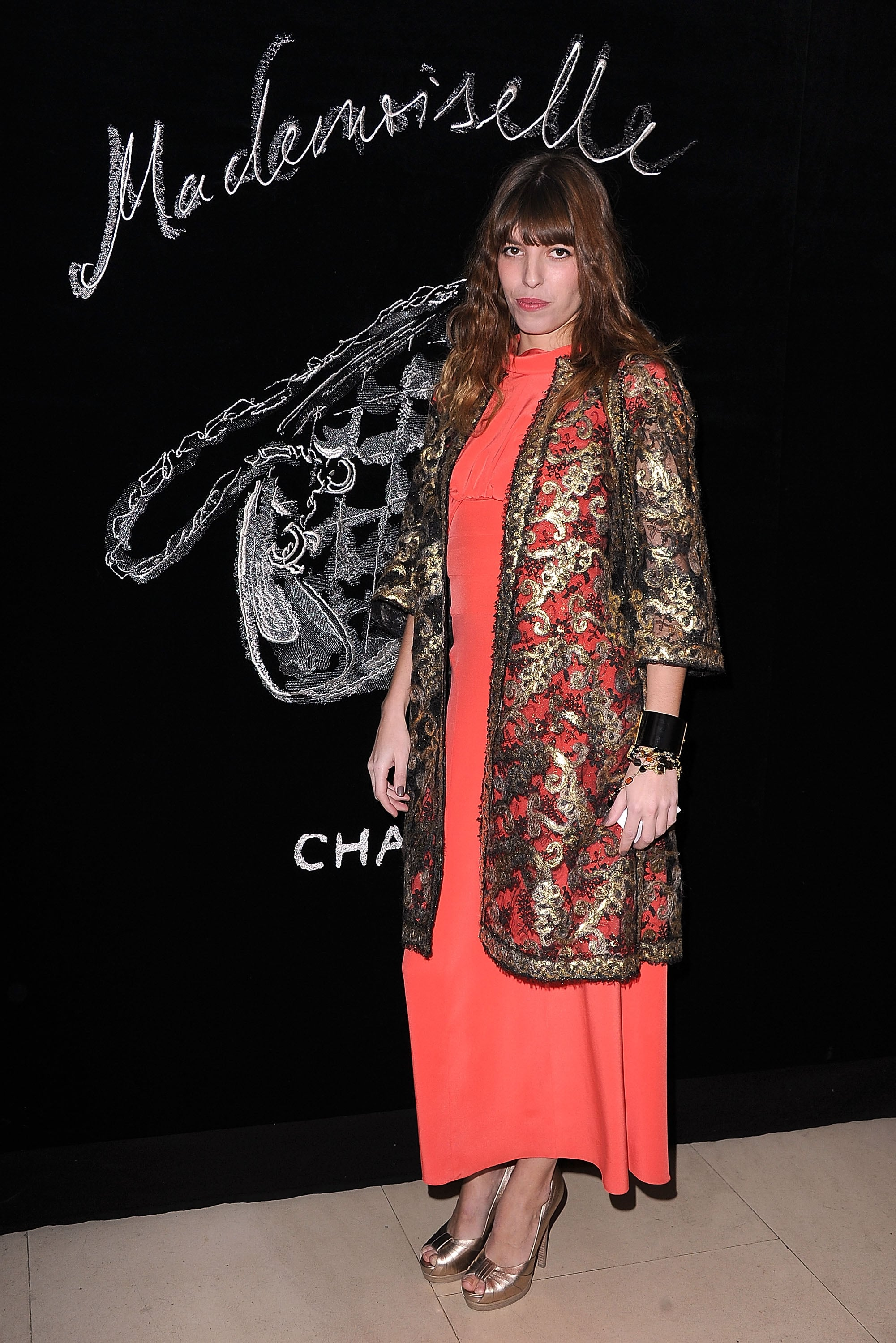 A dream in tangerine! Lou Doillon teamed her frock with a gold lace overcoat.