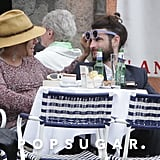 Sienna Miller had fun playing with Tom Sturridge's sunglasses during their vacation in Italy.