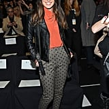 Shenae Grimes showed off her whimsical side in polka-dot pants and a silky orange top at Rebecca Minkoff. She then added a bit of edge via her black leather biker jacket and black leather booties.