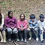 Kate Middleton sat on a long with children from Expanding Horizons primary school outdoor camp.