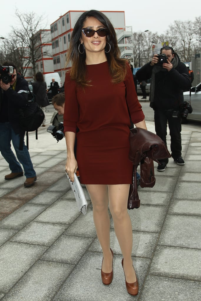 Salma Hayek added a white Balenciaga clutch to her little red dress at Balenciaga.