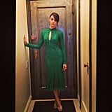 Emmy Rossum posed in a beaded emerald Monique Lhuillier dress before heading to the designer's Spring 2014 runway show. Source: Instagram user emmyrossum