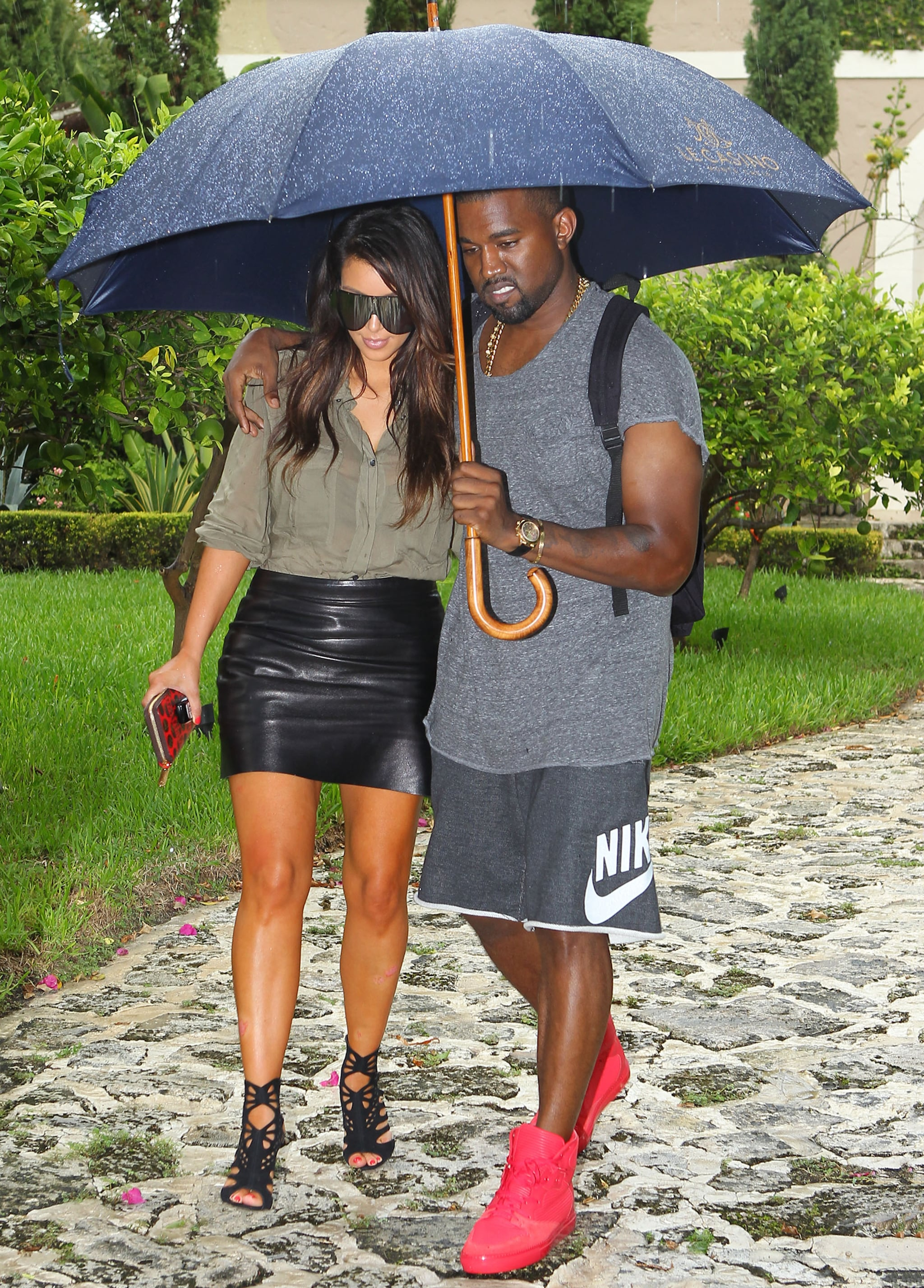 Kanye held onto Kim and an umbrella while they were out in Miami in October 2012.