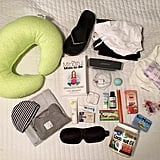 Deanna's bag included a Bose speaker and headphones, coconut oil, lavender oil, arnica gel, EOS lip balm, snacks, nursing bra and pads, nursing pillow, a sleeping mask, flip-flops, a zen parenting book, clothes, a swaddle, a onesie, and a hat.