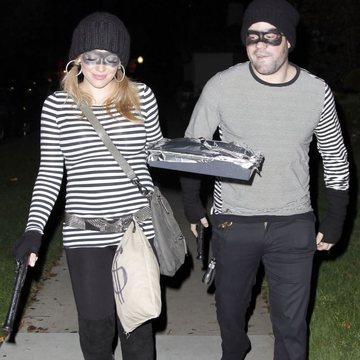 pregnant hilary duff and husband in robber costumes