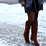 Knee-high boots made a sexy statement, even in the snow.