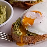 Smashed Avocado Toast With Poached Eggs and Lemon Juice