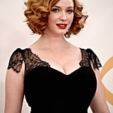 Christina Hendricks played up her amazing haircut with two-textured curls. Her hair was styled straight at the roots and curly around the ears. She finished it off with a classic red lip (of course).