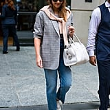 Casual and chic — Jessica dresses up an everyday outfit with a blazer and a cardigan wrapped around it.