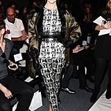 Jaime King donned a print ensemble from the designer and finished with a silky green Schumacher parka, black Jean-Michel Cazabat pumps, Iwona Ludyga leaf earrings, and black leather gloves at Lela Rose.