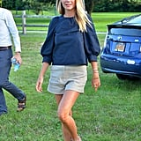 Gwyneth Paltrow Wearing a Black Blouse and Shorts
